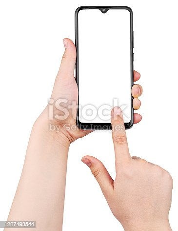 Boy's Hands Uses Smartphone Isolated on White Background. Сhild's  Hands Hold Black Smartphone and Finger Touches the Screen at Vertical Position. Screen Blank. Close-Up.