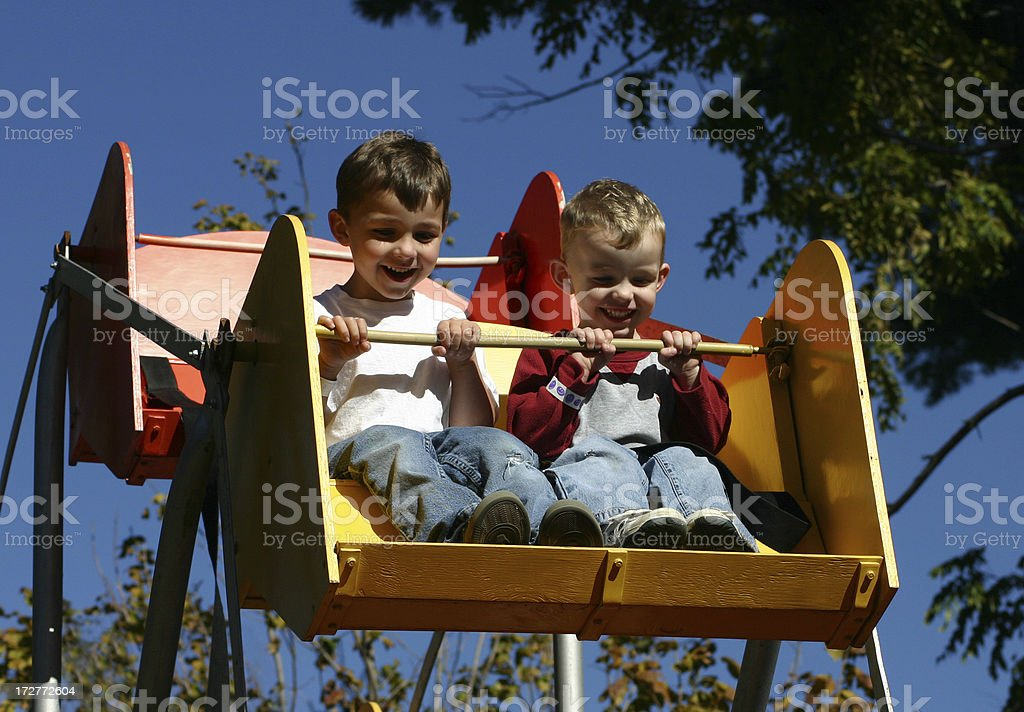 Boys having fun on Ferris Wheel royalty-free stock photo