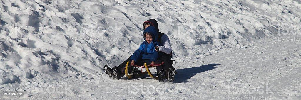 Boys having fun sled winter sport sledding swiss alps stock photo boys having fun sled winter sport sledding swiss alps royalty free stock photo publicscrutiny Gallery