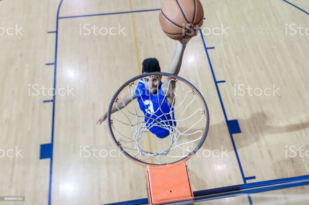 African American player dunking