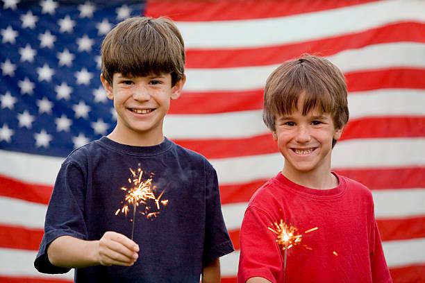 Boys Holding Sparklers stock photo