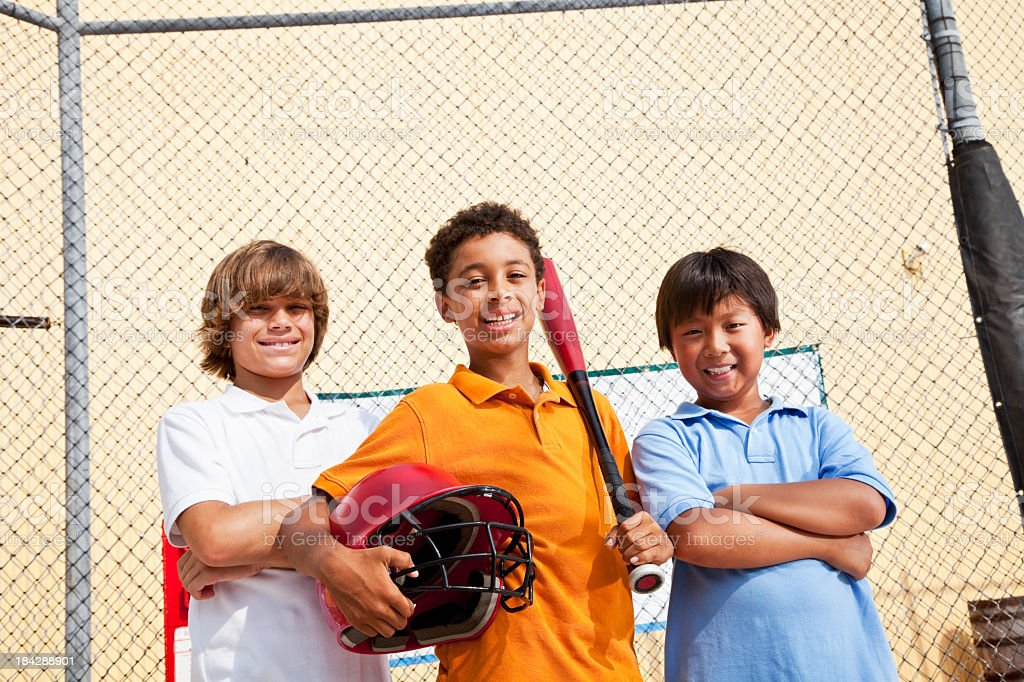Boys in batting cage royalty-free stock photo