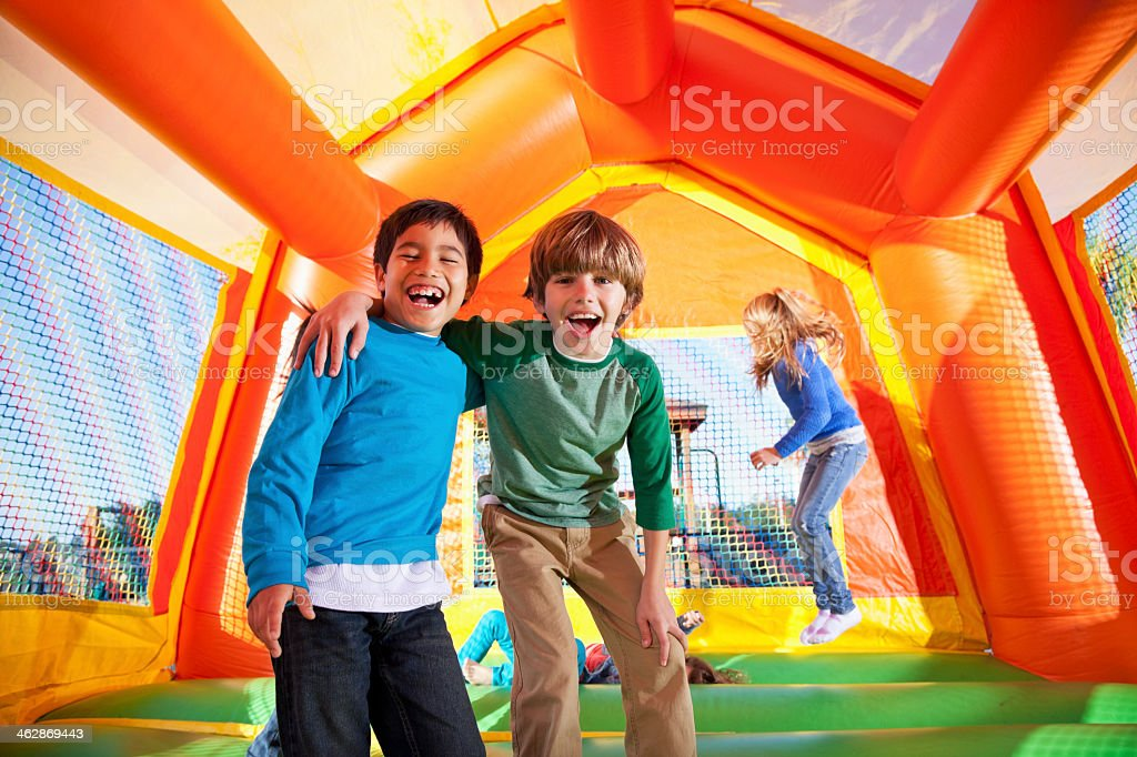 Boys in bounce house royalty-free stock photo
