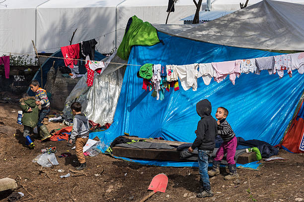 Boys in refugee camp in Greece stock photo