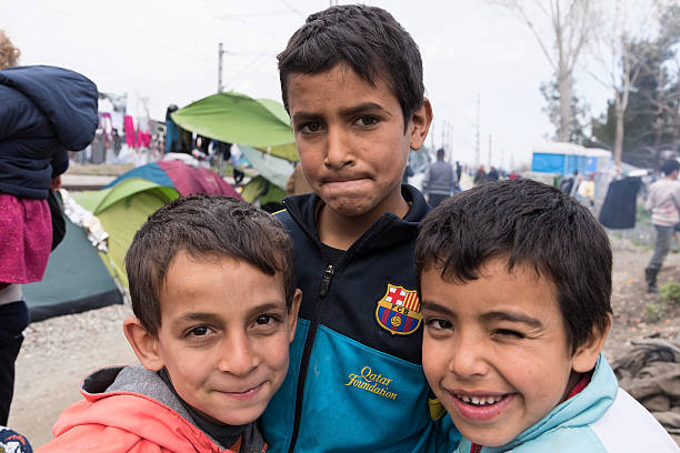 Boys in refugees camp in Greece stock photo