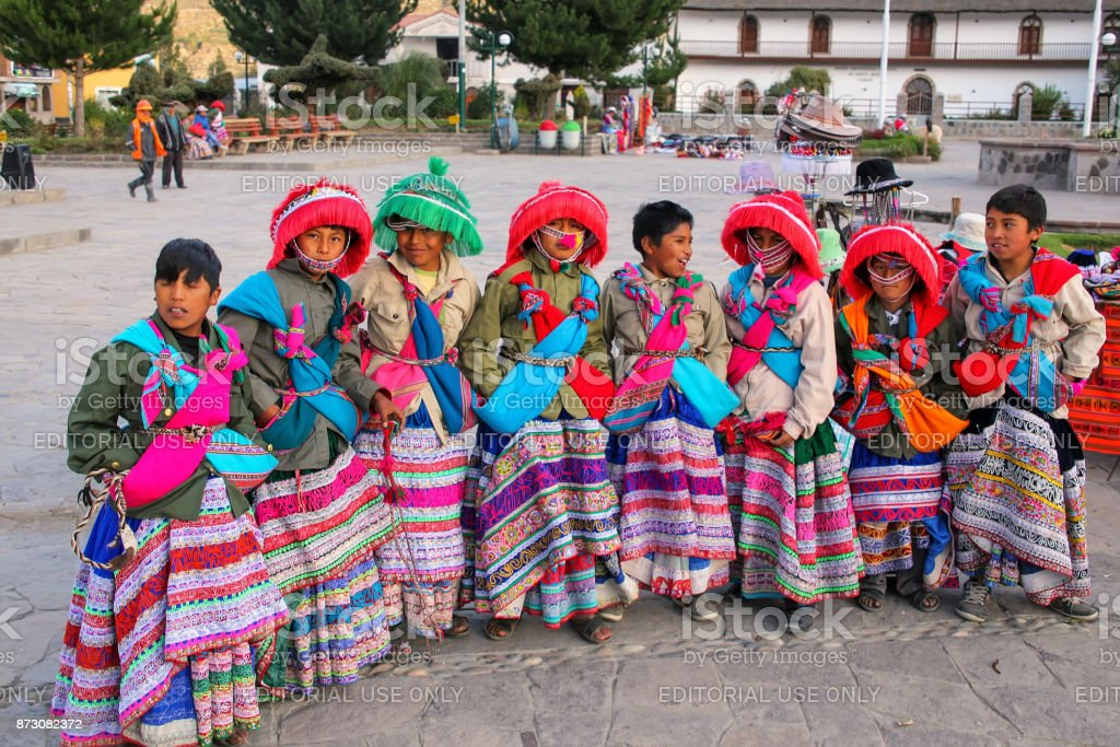 Boys in traditional costumes standing in Yanque town stock photo