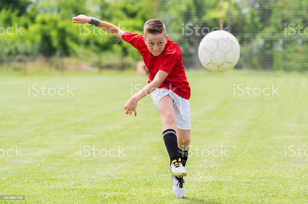Little Boy Shooting at Goal