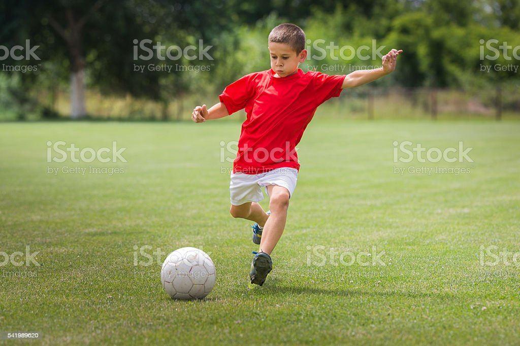 Boys kicking ball – Foto
