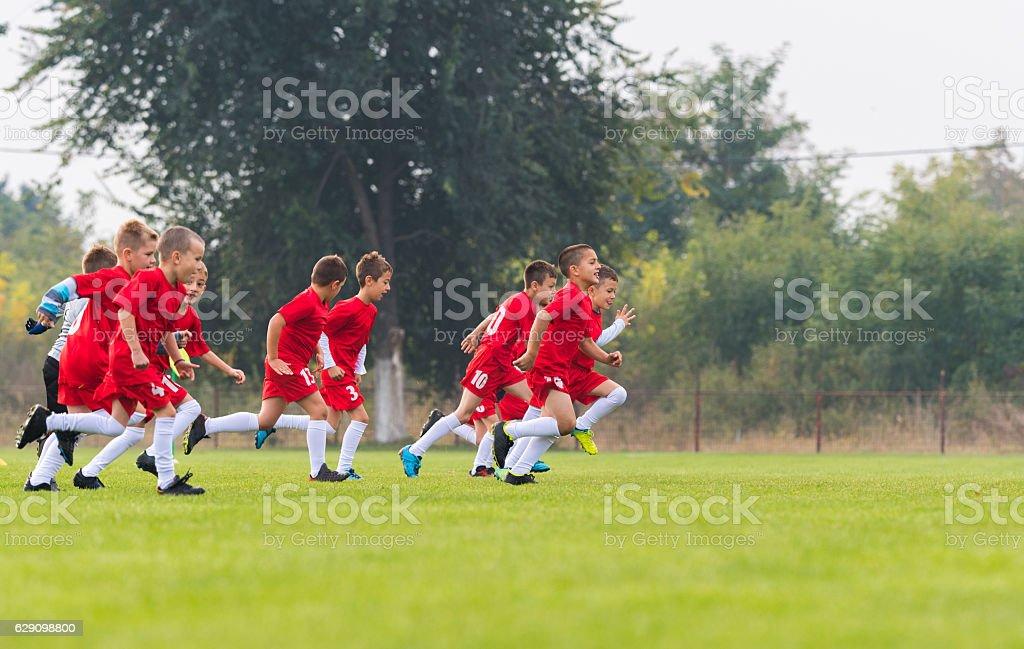 Boys kicking ball stock photo
