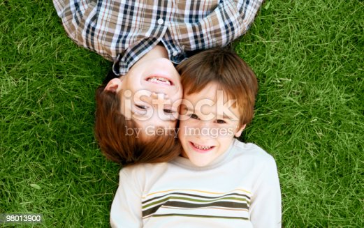 Boys Laying In The Grass Stock Photo & More Pictures of American Culture