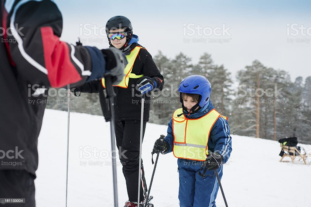 Boys learn to ski royalty-free stock photo