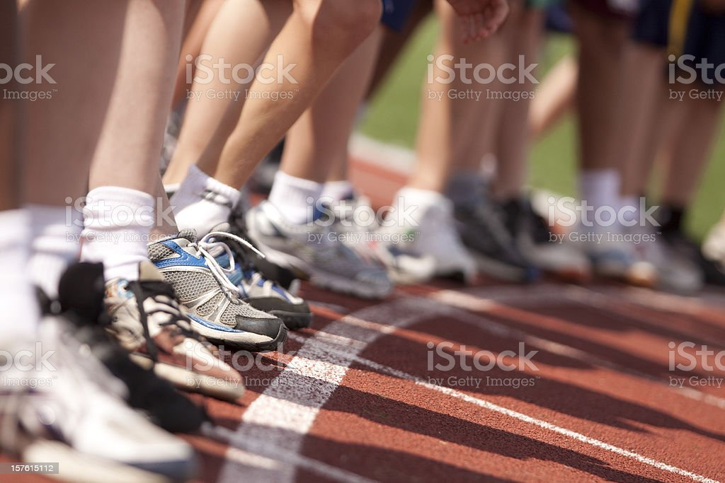 Boys lined at starting line for running race stock photo