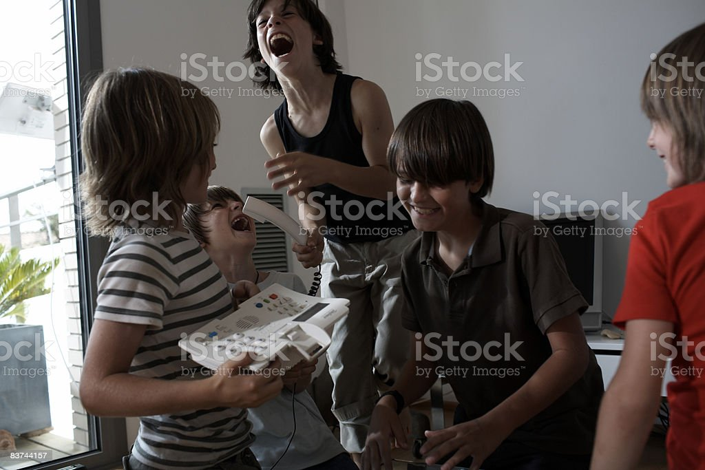 boys make a prank call royalty-free stock photo