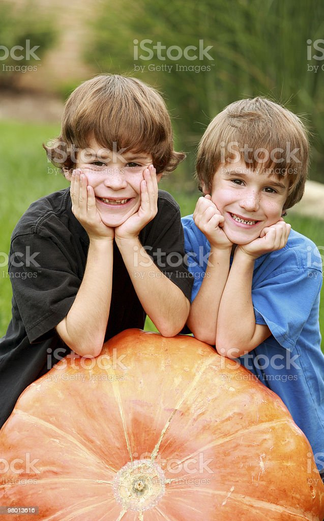 Boys on a Pumpkin royalty-free stock photo