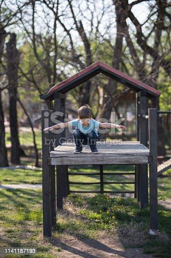 Boys on playground ready to jump
