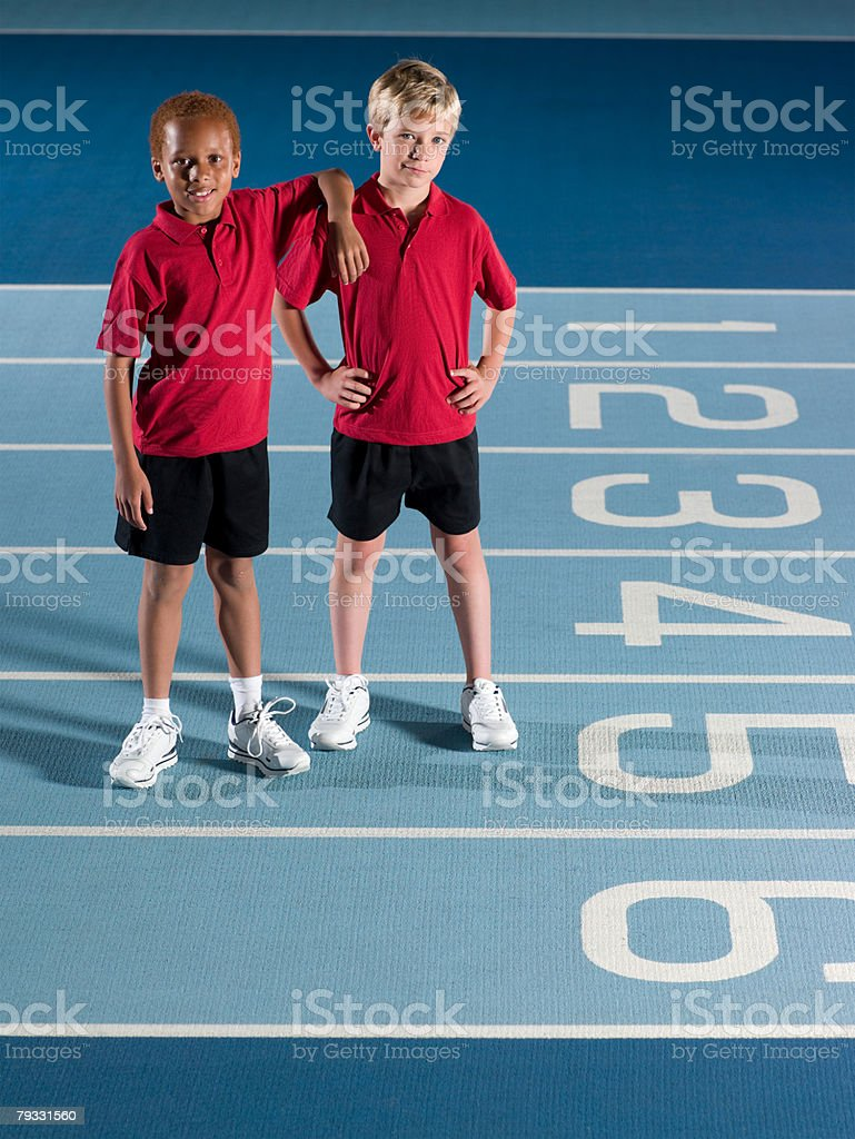 Boys on running track royalty-free stock photo