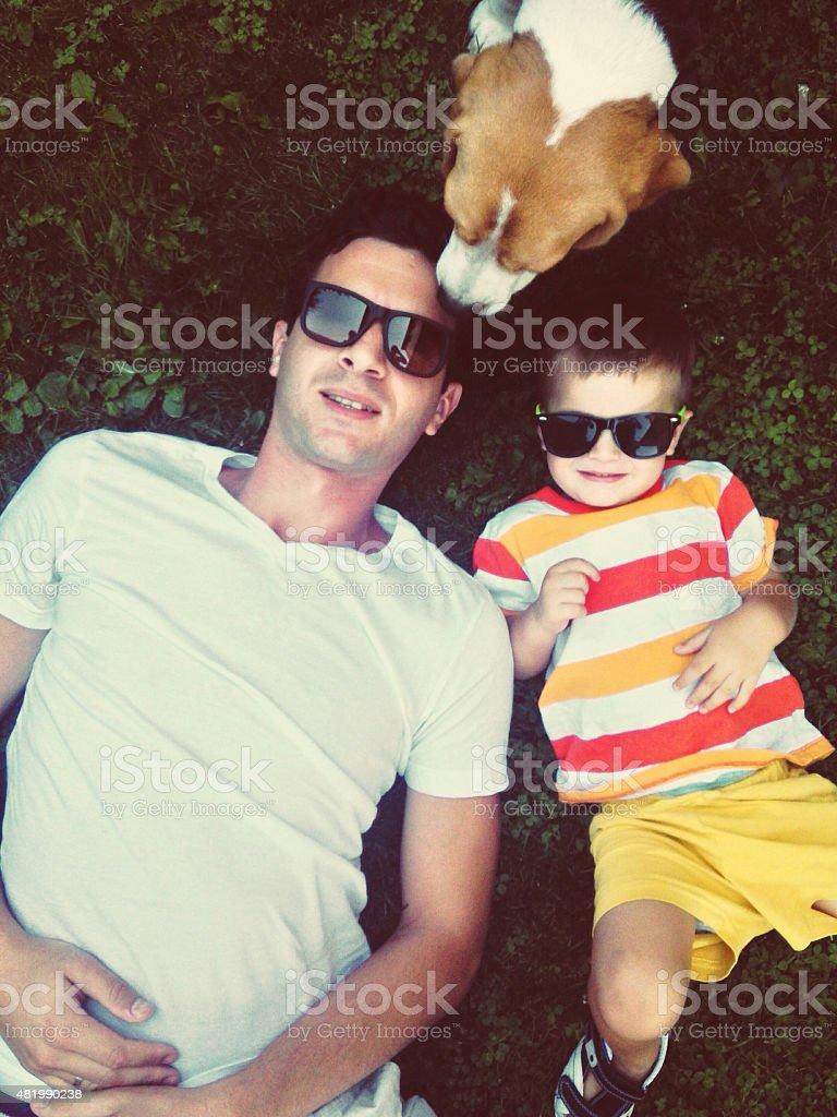 Boys on the grass stock photo