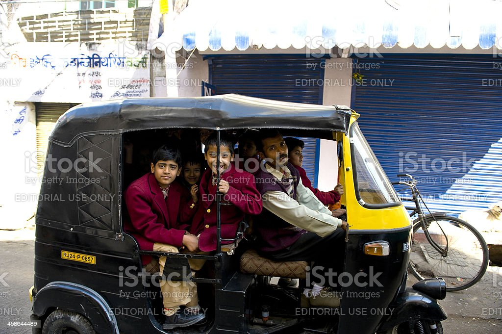 boys on the way home by taking auto rickshaw royalty-free stock photo