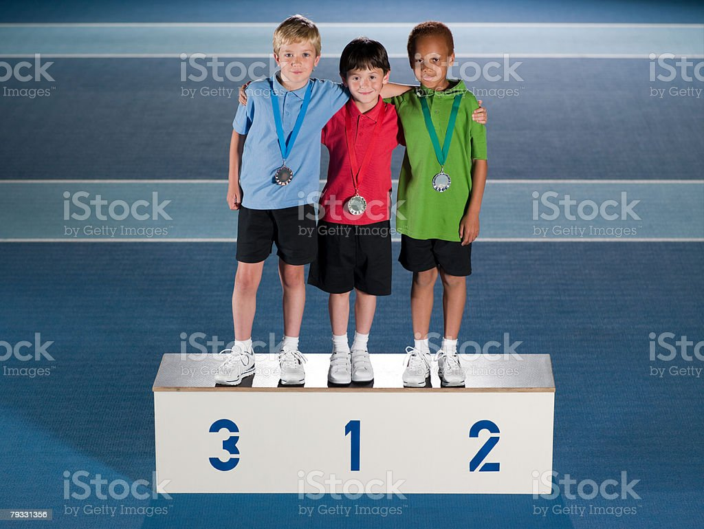 Boys on winners podium royalty-free stock photo