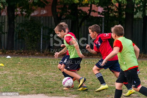 621475196 istock photo Boys play football on the sports field 621500226