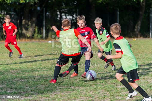 621475196 istock photo Boys play football on the sports field 621500538