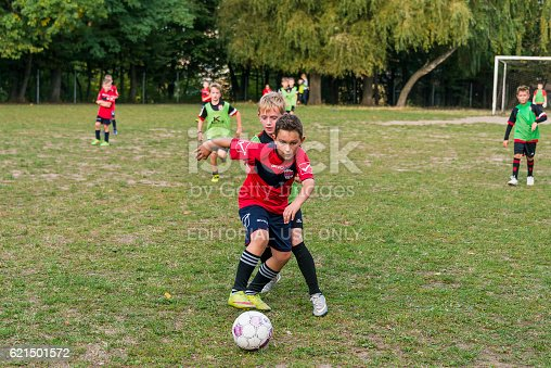 621475196 istock photo Boys play football on the sports field 621501572