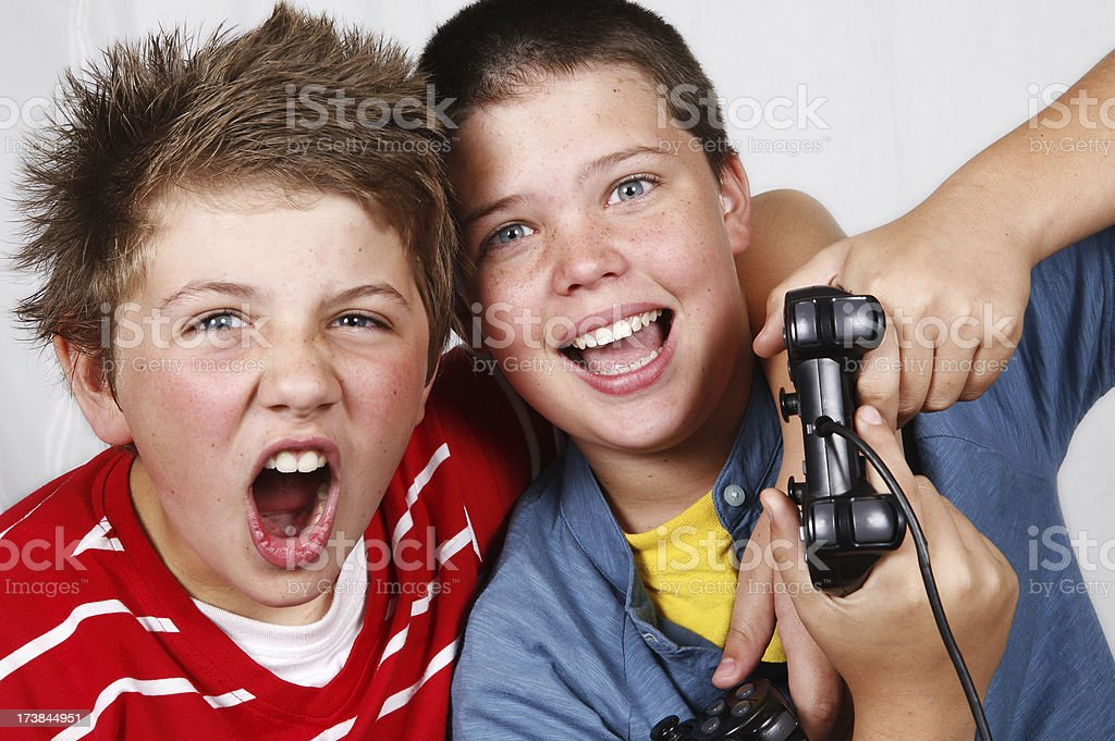 Boys playing exciting TV games royalty-free stock photo