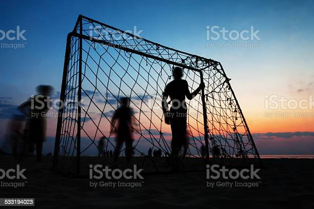 Boys playing football on the beach in summer picture id533194023?b=1&k=6&m=533194023&s=612x612&h=bmhygb05pr2jyio gpimqke fvroeyk x2gakqh8zem=