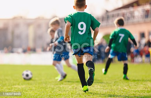 istock Boys playing in a soccer match 1150073443