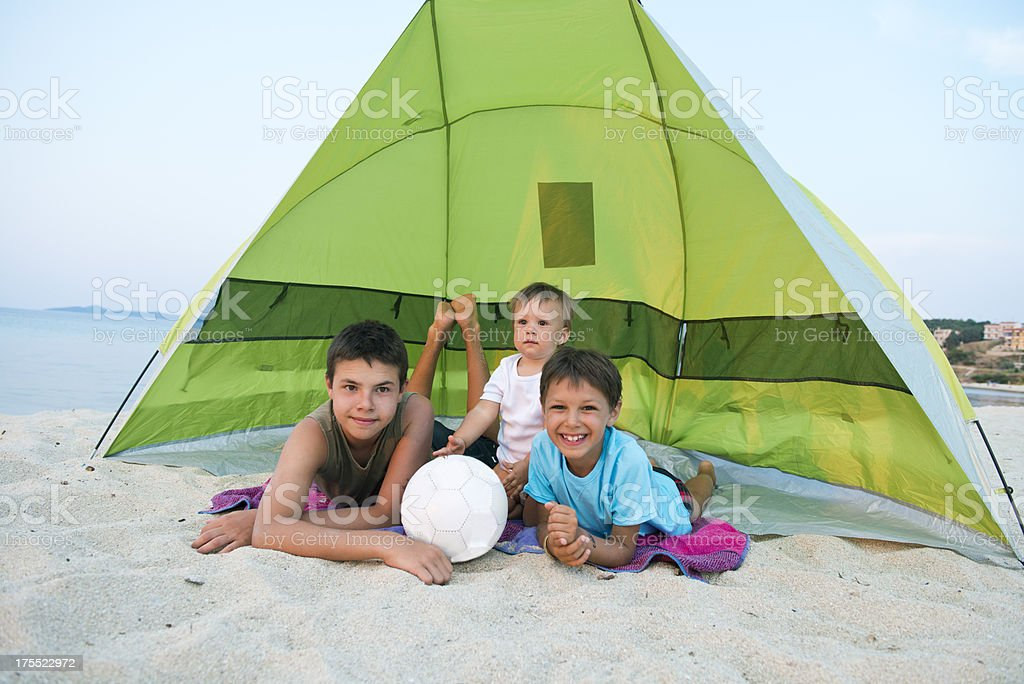 Boys playing in camp stock photo