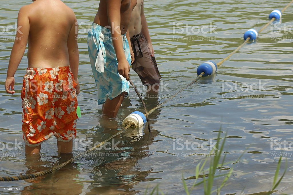 Boys Playing in Water stock photo