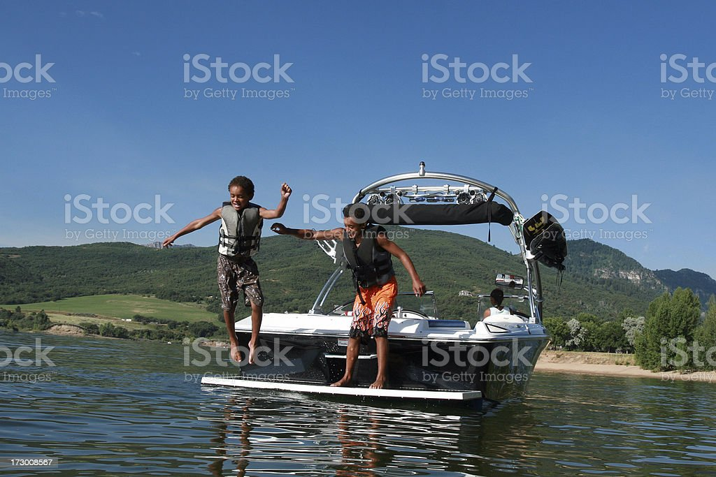 Boys Playing on the boat stock photo