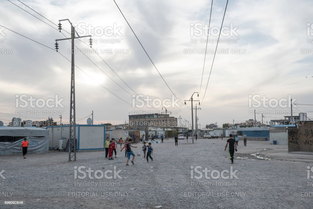 Boys playing soccer at Christian IDP camp, Erbil, Iraq stock photo