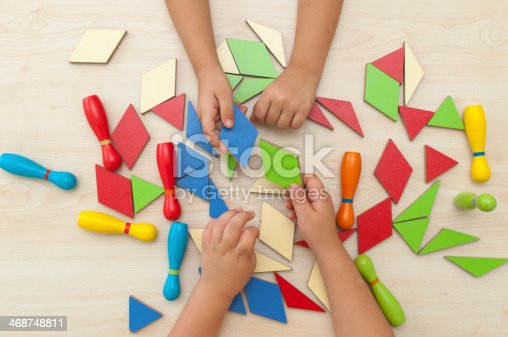 514261930 istock photo boys playing tangram puzzle 468748811