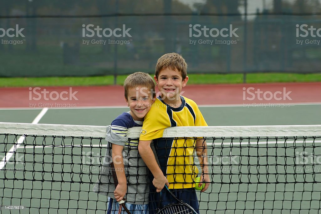 Boys Playing Tennis stock photo
