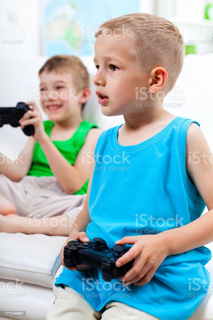 Boys playing video games royalty-free stock photo