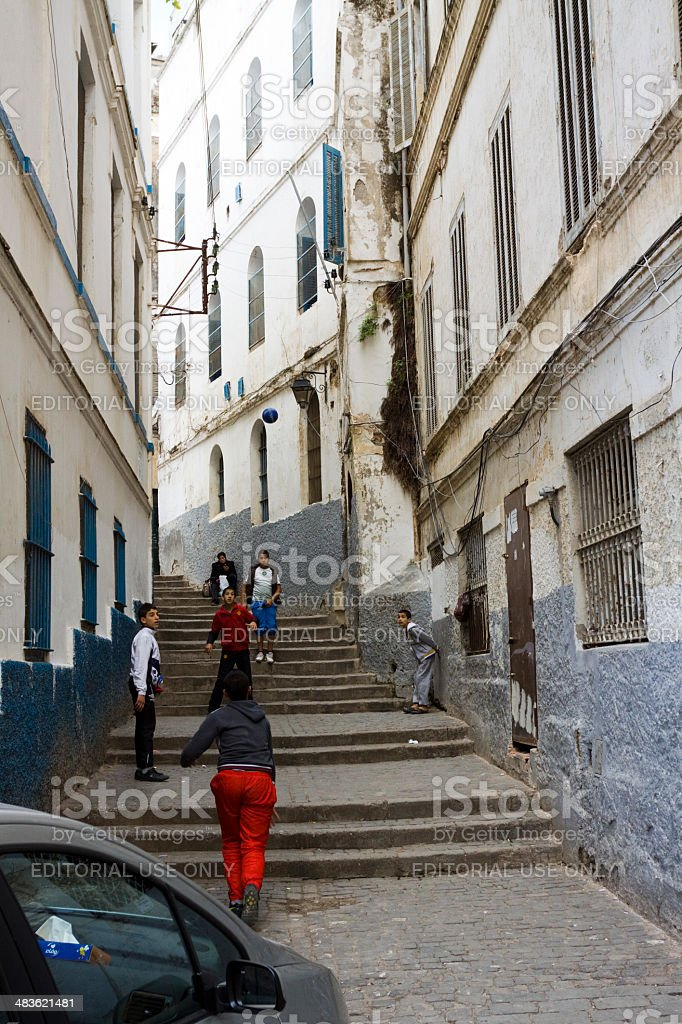 Boys playing with football in Casbah of Algiers royalty-free stock photo