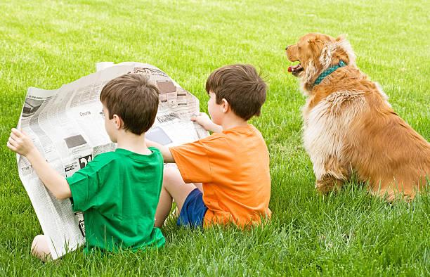 Boys Reading the Newspaper stock photo