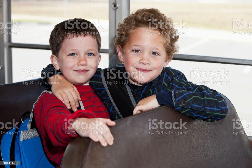 Boys riding school bus stock photo