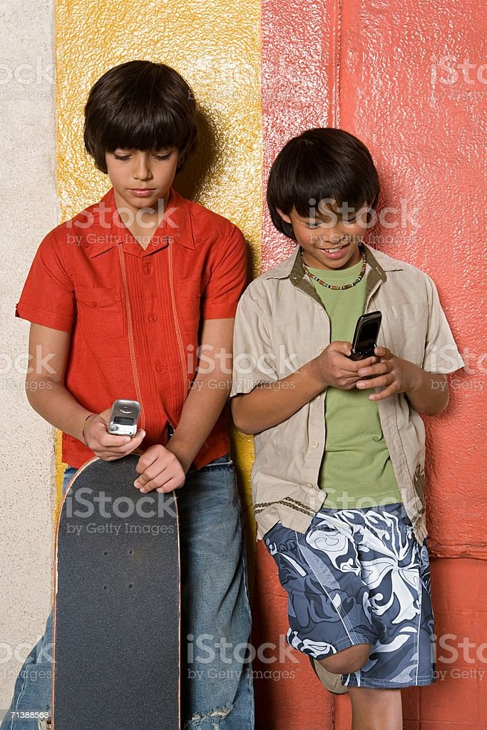 Boys sending text messages royalty-free stock photo