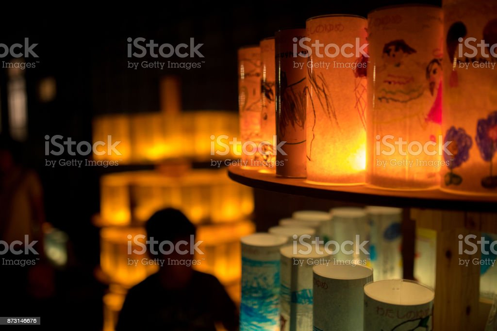 Boy's silhouette in candle light festival stock photo