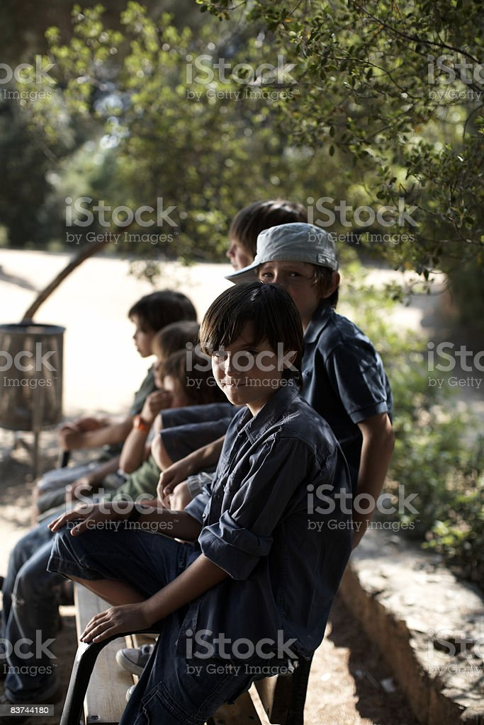 boys sit on park bench royalty-free stock photo