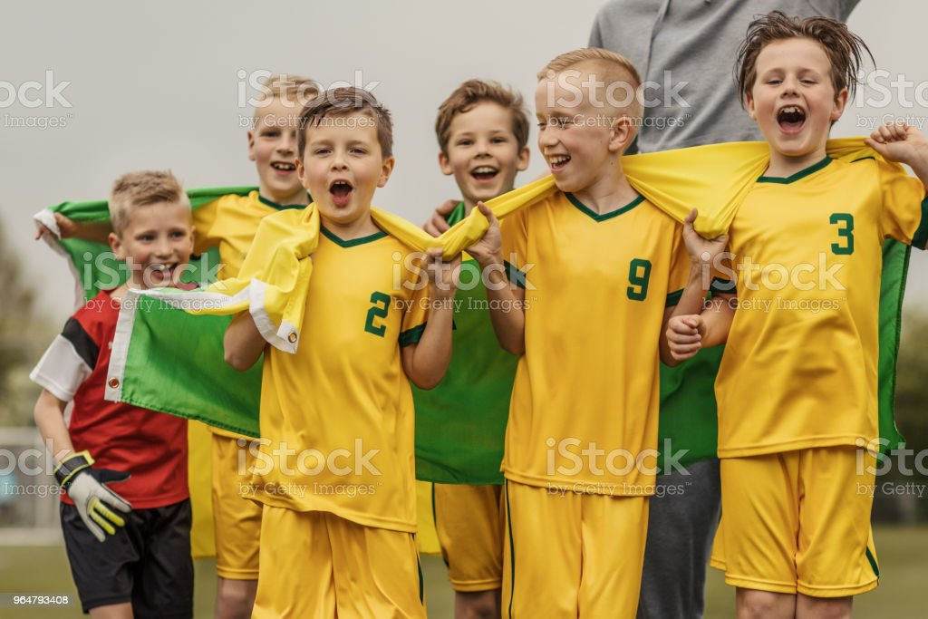 A boys soccer team celebrating a victory royalty-free stock photo