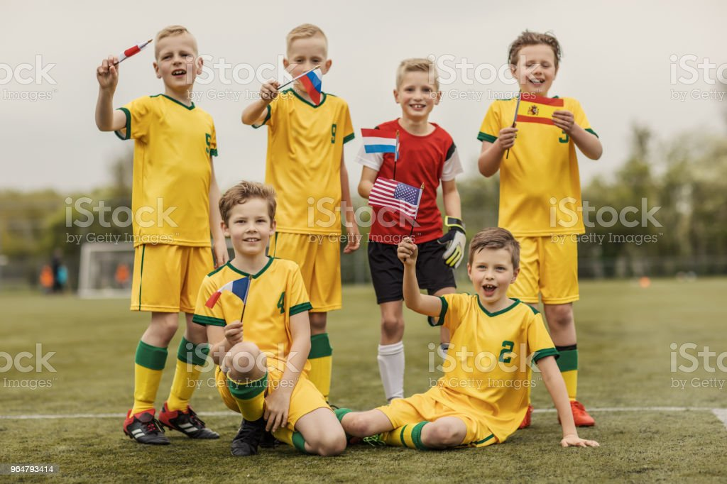 A boys soccer team celebrating a victory royalty-free stock photo