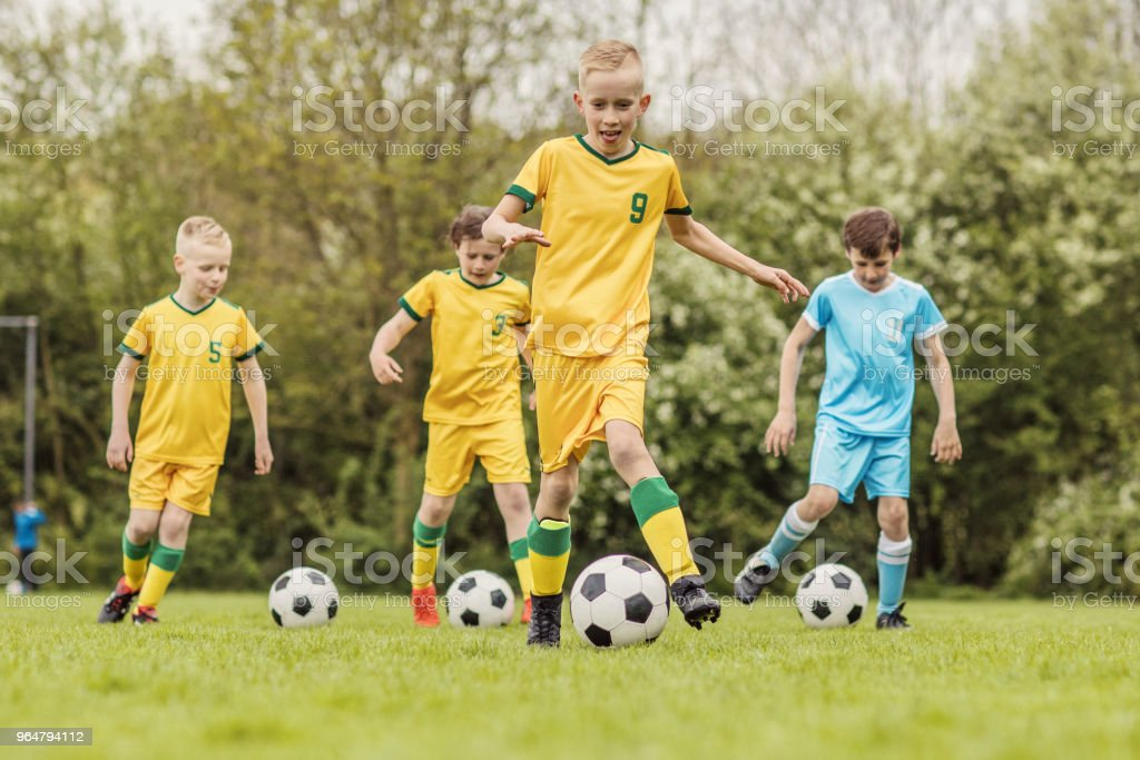 A boys soccer team during an intense football training session royalty-free stock photo