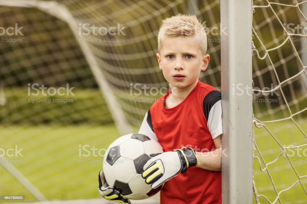 A boys soccer team goalkeeper royalty-free stock photo