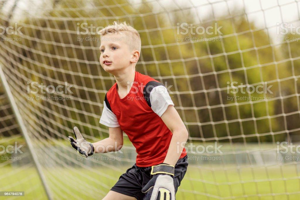 A boys soccer team goalkeeper royalty-free stock photo