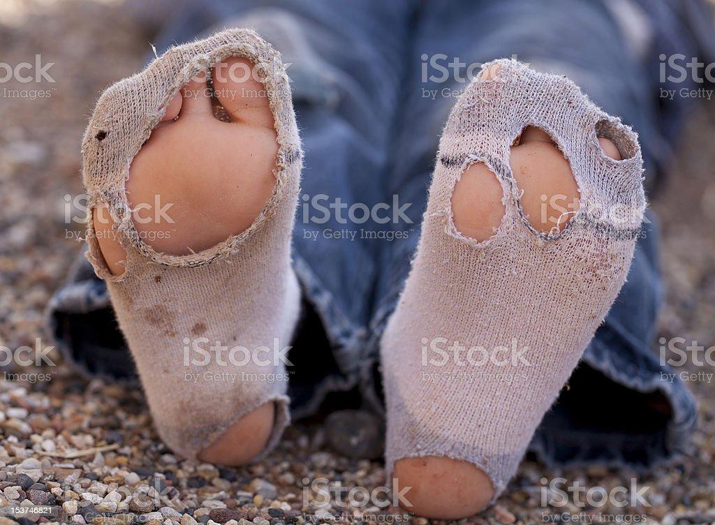 Boys Socks With Many Holes stock photo