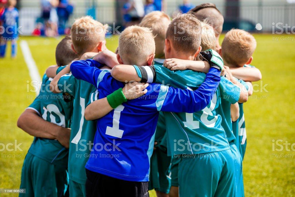 Boys\' sports team huddling. Children playing sports in a team. Team...