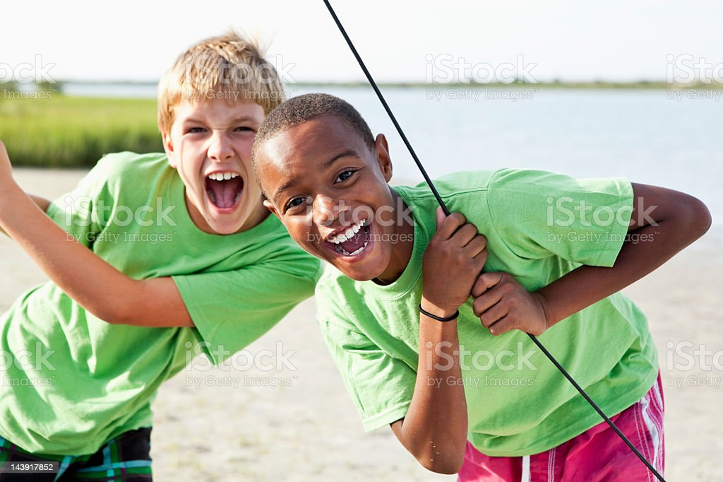 Boys standing on catamaran royalty-free stock photo